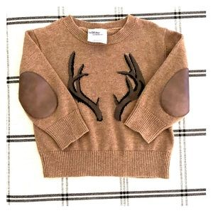 Handsome sweater with leather elbow accents